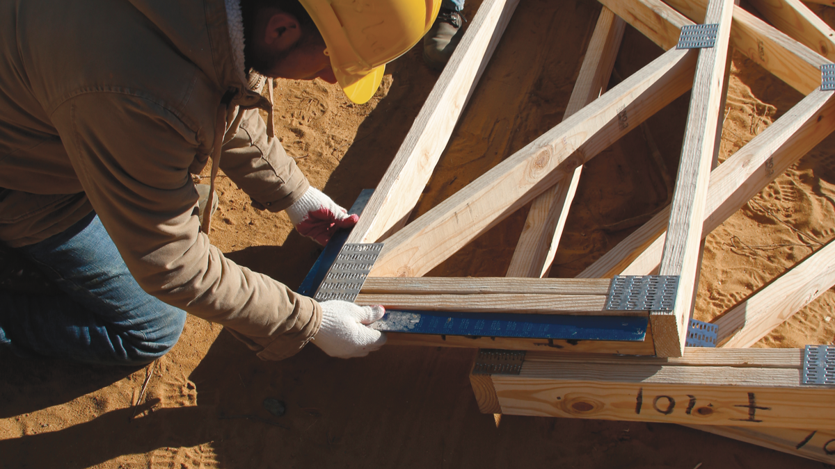 Check for square. If one or two trusses have an end out of square, we plane off the difference with a power planer. If an end is significantly out of square, we contact the truss manufacturer for a field fix or a replacement truss. If we find a top or bottom chord that is proud of the end, we trim it with a circular saw. Sometimes you have to trim a truss plate too.