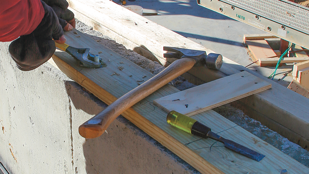 Make it flush. Once the countersink is complete, we add the nut and washer and tighten them down. Before installing the floor sheathing, we add an epoxy anchor on one side of the truss to compensate for the loss of holding strength caused by the countersinks.