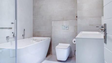 bathroom with curbless shower and freestanding tub