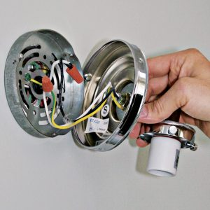3 Use wire connectors to splice the supply neutral to the fixture neutral, and the supply hot wire to the fixture hot wire.
