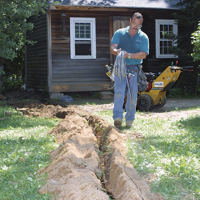 1 As you walk along the trench, unwind the cable. Ideally, it should lie flat in the bottom of the trench.