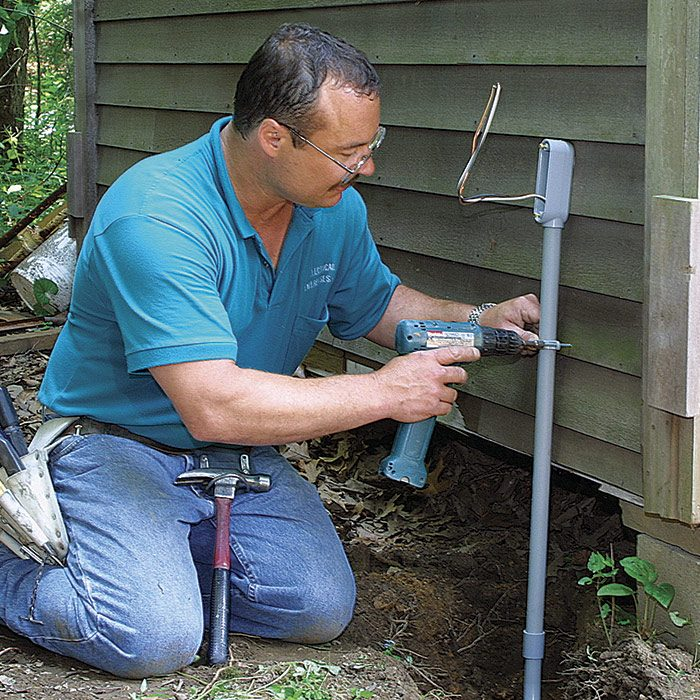 3 Strap rigid PVC pipe (with LB conduit) to the outbuilding.