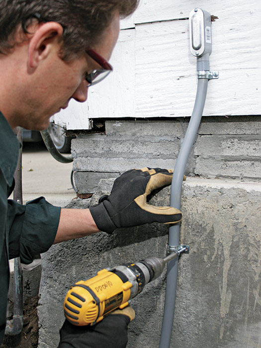 Use straps to secure the pipe to exterior walls and foundations.