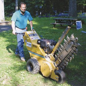B Rent a ditch-digging machine, also known as a trencher, to save time and avoid a sore back.
