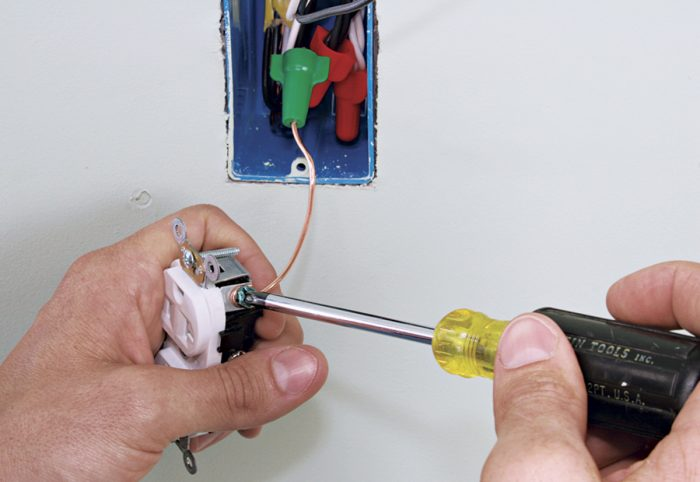 Attach ground pigtails to green ground screws.
