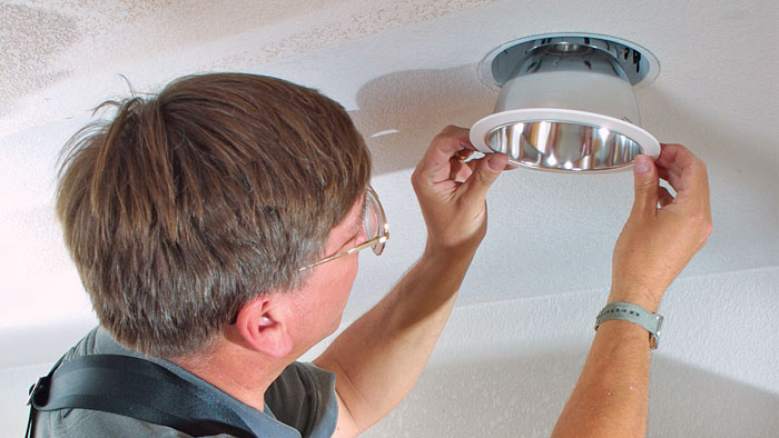electrician installing recessed light