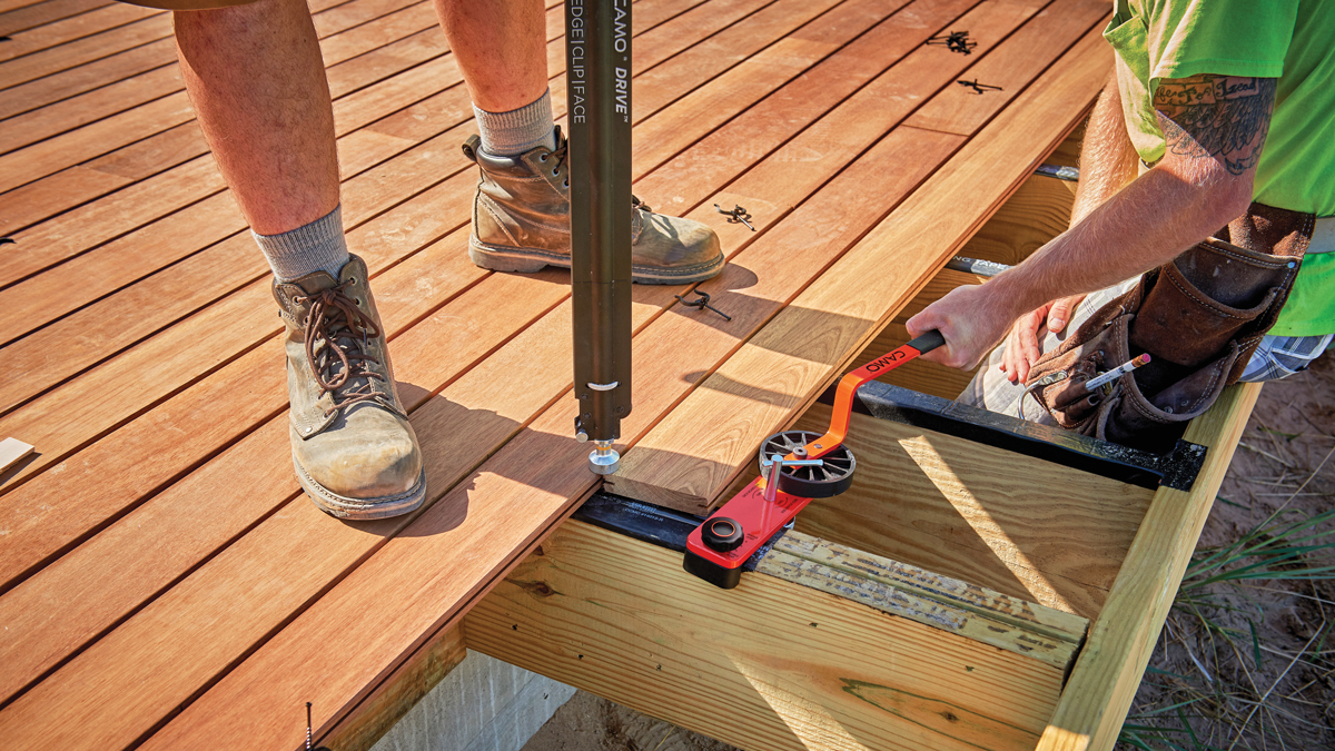 xB<strong>etter bender.</strong> The Camo Lever uses an eccentric cam to push resistant deck boards into place, and then holds them there for fastening. Notably, it works with both steel and wood joists.