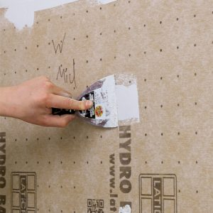Walls are easy. Foamboard cuts with a utility knife and attaches with specialized screws. Run a bead of sealant between each panel and trowel more over the seams, then coat fasteners and seal around penetrations.