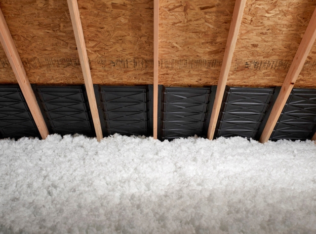 This attic was insulated with blown-in fiberglass.