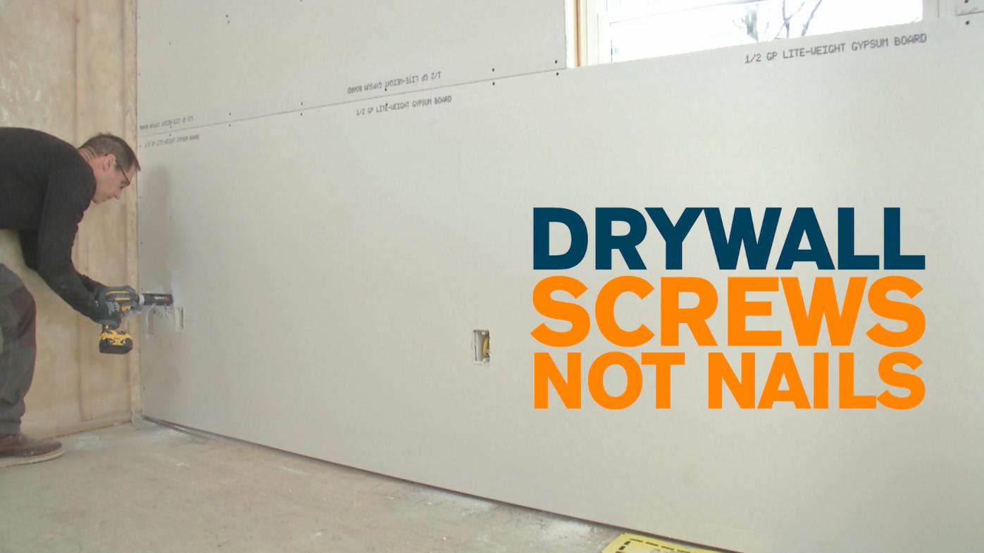 Myron puts a screw into drywall