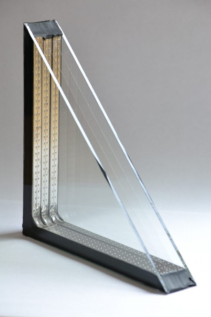 A section of an Alpen window with two suspended layers of Heat Mirror film