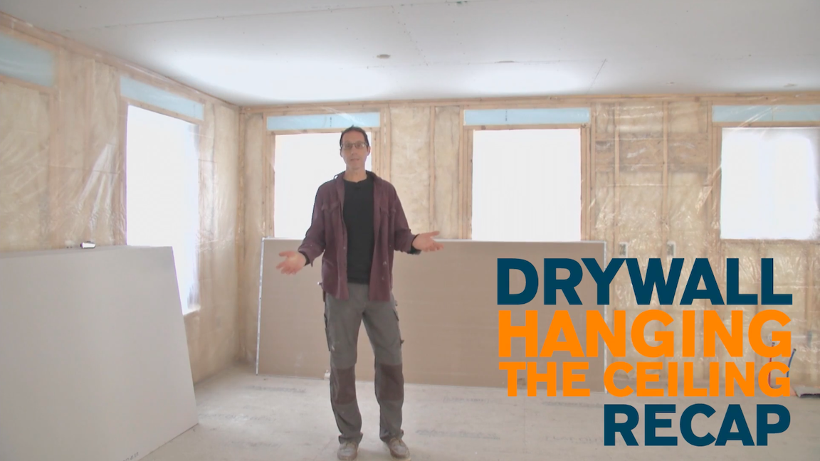 Myron stands in a room under construction with text on screen saying Drywall Hanging the Ceiling Recap