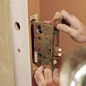 Holes in the lock case should align with the holes drilled into the door face