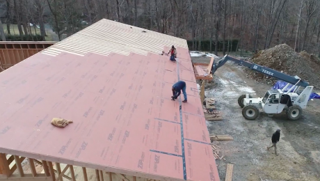 Workers installing a roof