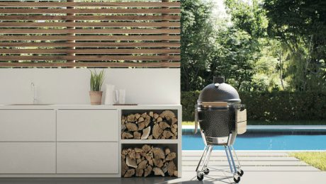 White outdoor countertop next to bbq by a pool