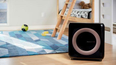 Black air purifier in a kid's room