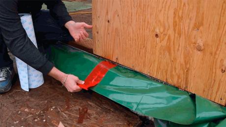 Josh Salinger demonstrates how an air barrier works