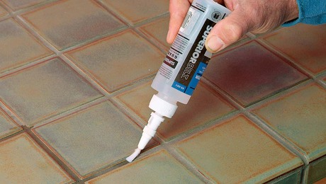 You can apply a penetrating sealer directly to the grout.