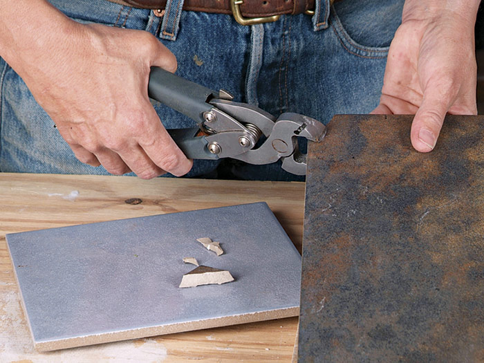 Although it's expensive and a bit messy, an electric water saw can make all your tile-cutting chores much easier.