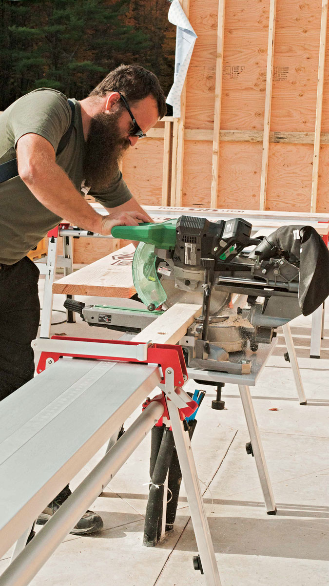 Tape on top. The Cut Hub has a wide aluminum top with a built-in tape measure that works with the adjustable stop. Two of these sawhorse modules connect with telescoping aluminum rails to create a mount for a miter saw.
