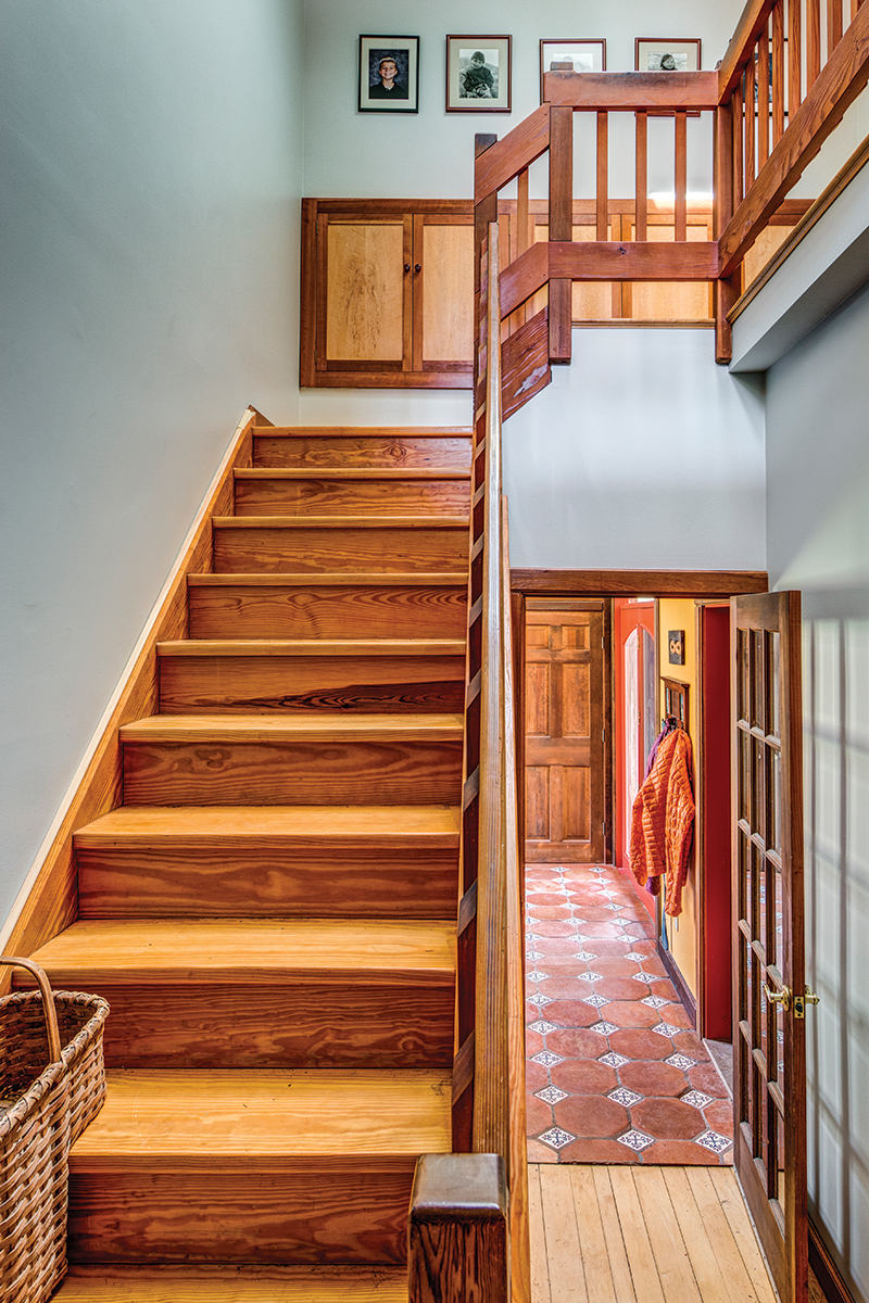cool gray walls in a hallway with wood stairs