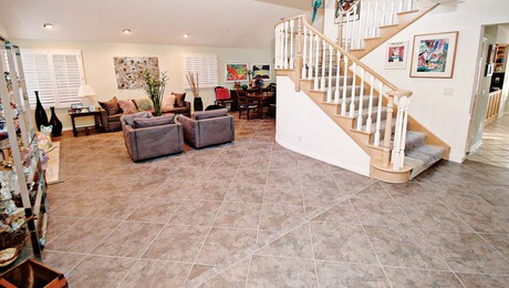 Large diagonally set porcelain tiles create a beautiful, durable floor that covers this home's entry area, hallway, and living/dining areas.