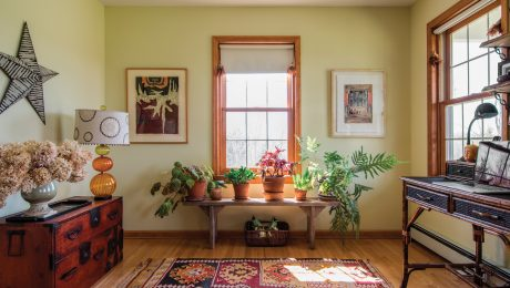 A room with green walls and warm wood