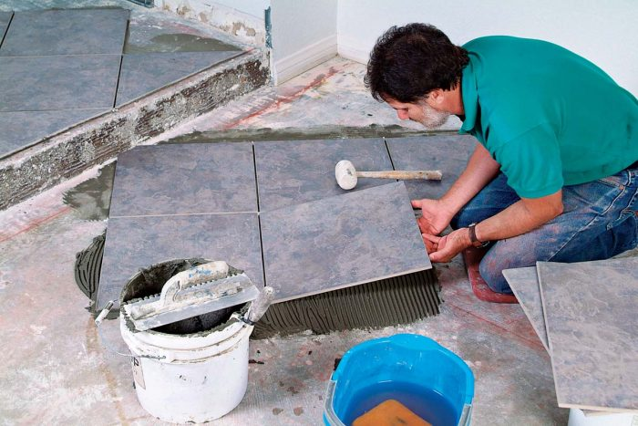Large floor tiles require large-format thinset to support the weight and aid in leveling the tile.