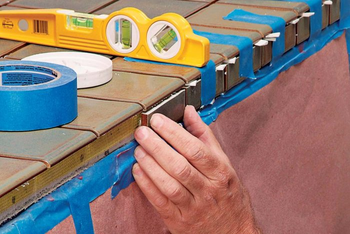 Quick-setting adhesives work well for tiling vertical surfaces.