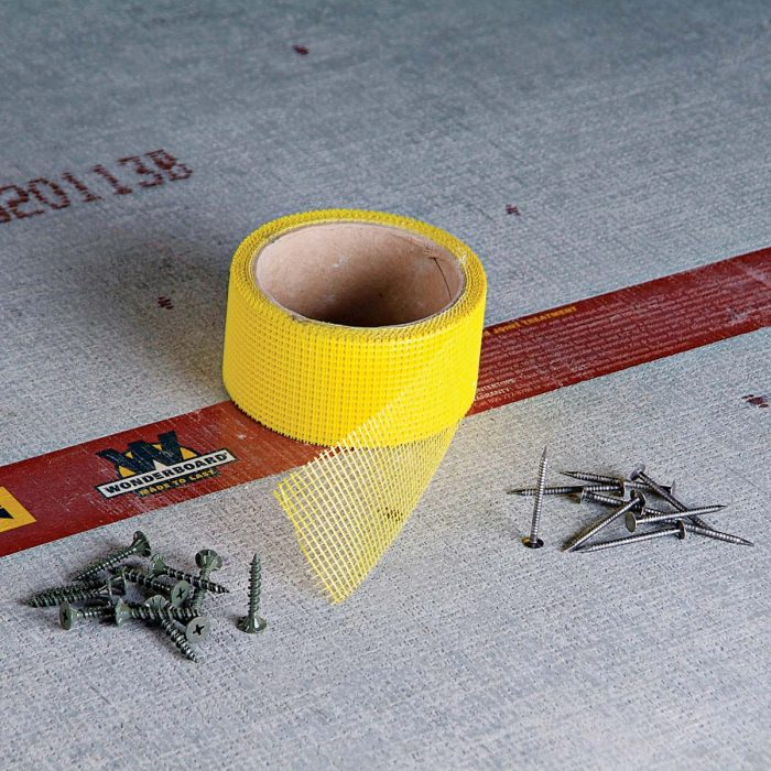 Fiberglass tape with adhesive helps bridge gaps, for a long lasting backerboard installation.