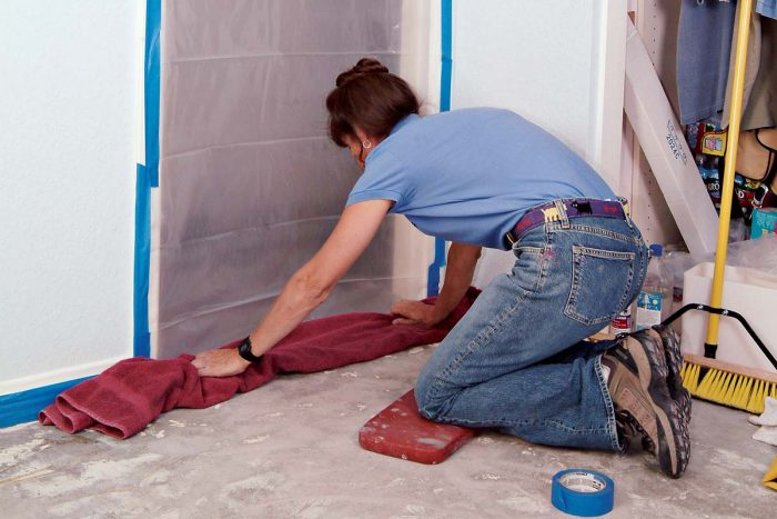 A towel at the doorway will secure the plastic sheeting.