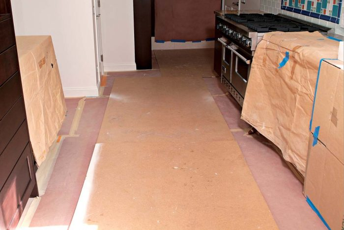 Rosin paper covered by Masonite provides thorough protection for any finished floor.