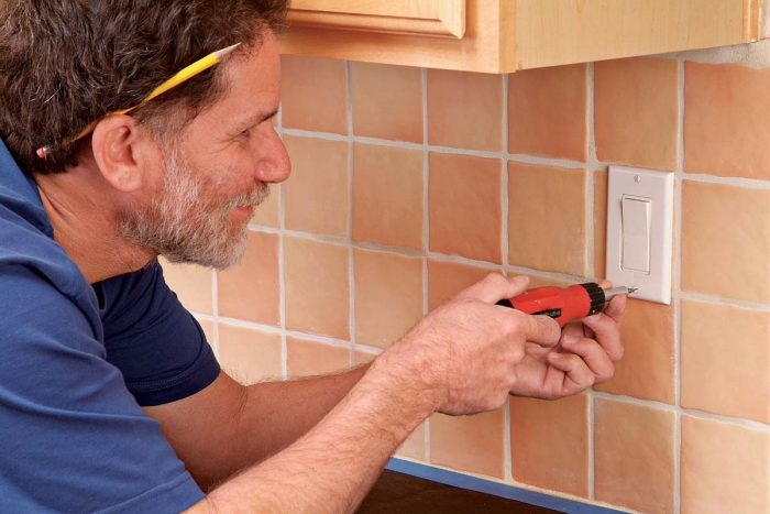 Remove electrical outlet faceplates, saving the screws in a labeled, plastic bag.