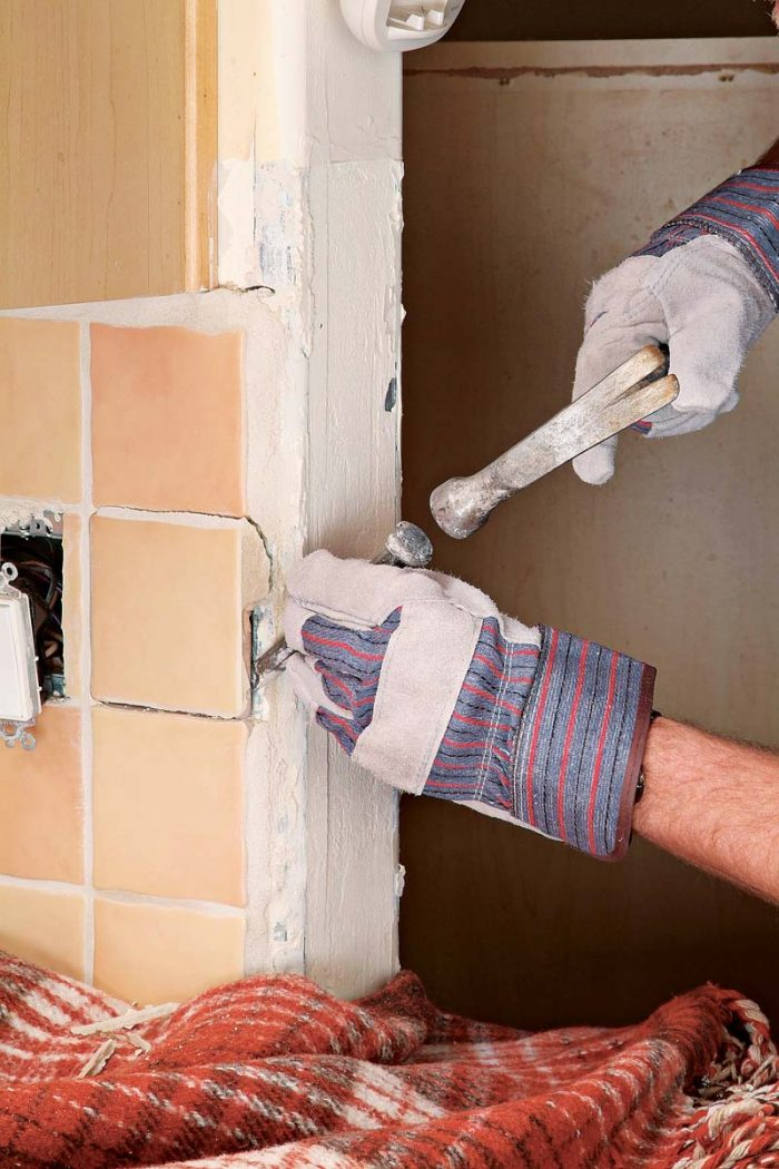 Carefully use a hammer and chisel to remove edge tiles.