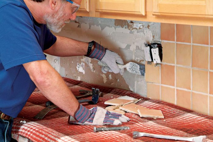 A margin trowel may also be used to lift or pull tiles away from the wall.
