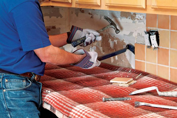 Carefully remove backsplash tiles, to prevent excessive damage to the drywall.