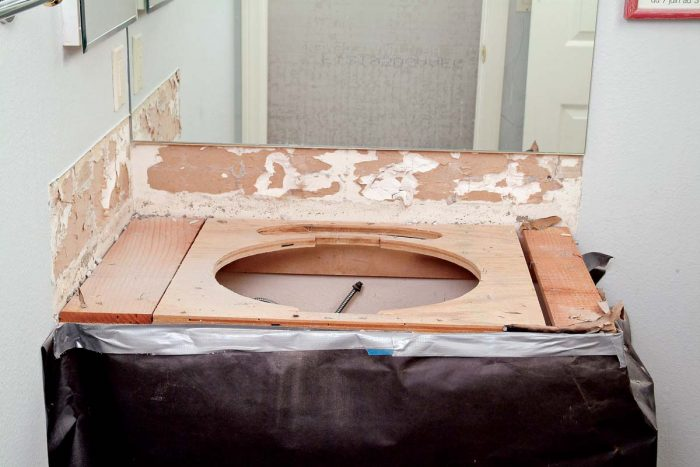 If the old rough top is level and has no water damage, waterproof it and proceed with the tile installation.