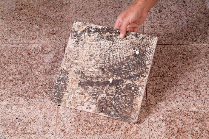 Tile installed on a concrete floor with old mastic left on it won't bond properly and, eventually, will come loose.