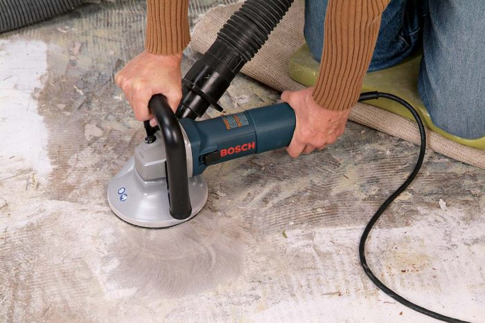 You can reduce small bumps in a concrete floor with a concrete grinder, connected to a shop vacuum to reduce dust output.