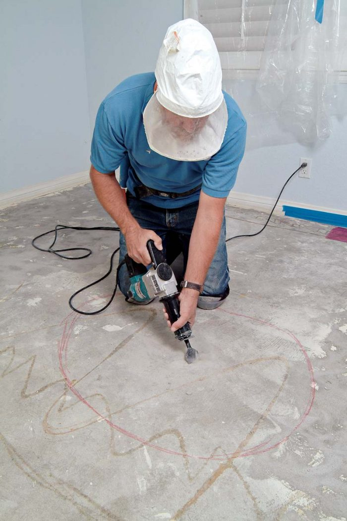 Use a chipping hammer to remove excess concrete from high spots or small hills.