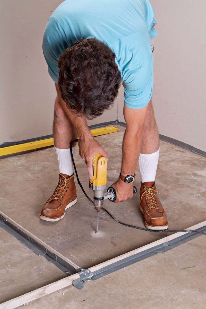 To determine the amount of self-leveling compound required, first drill holes for screws.