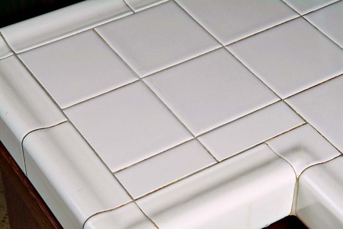 Narrow cut tiles aren't a first choice, but sometimes they allow the rest of the countertop to lay out beautifully.