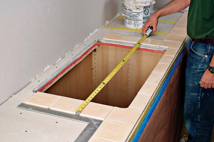 Plan your layout carefully around sinks and other focal points to keep cut tiles symmetrical.