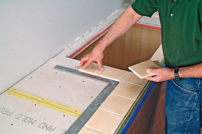 Dry-lay the tile on your work surface to check spacing and cuts.