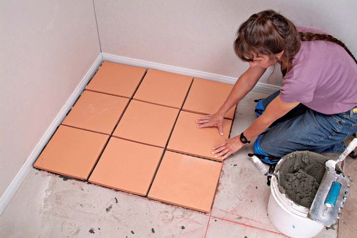 Before setting tiles, lay down a grid line so that you can fit nine tiles within each grid.