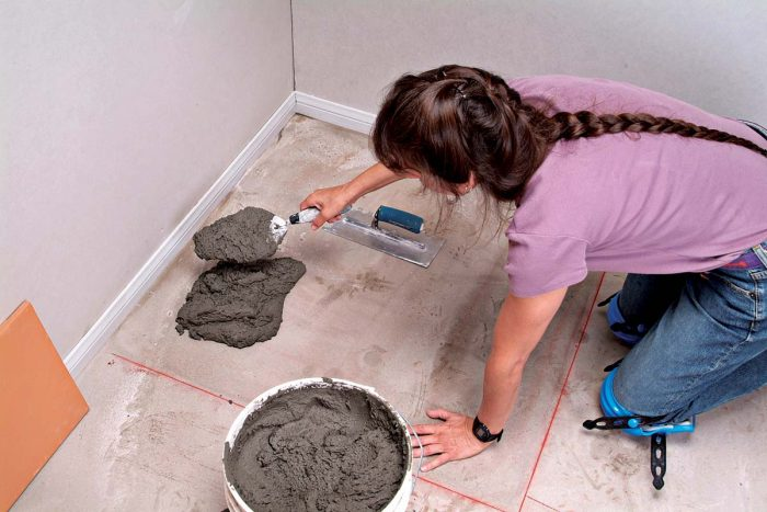 Scoop a large amount of thinset onto the floor with a trowel.