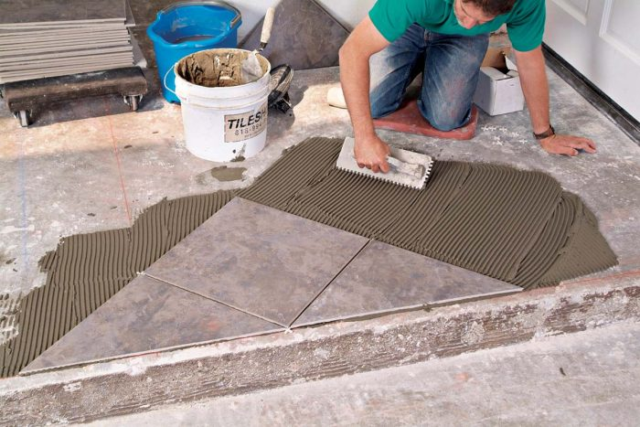 Combing thinset in one direction for each new section provides good adhesion for the next tiles.
