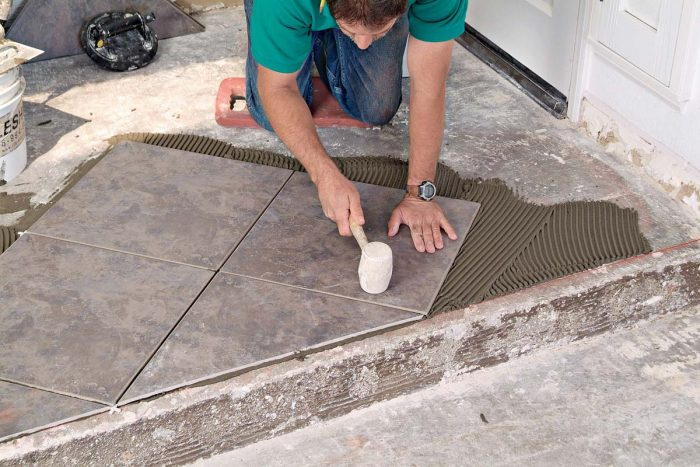 Tap on the tile with your mallet in several locations to help embed the tile in the thinset.