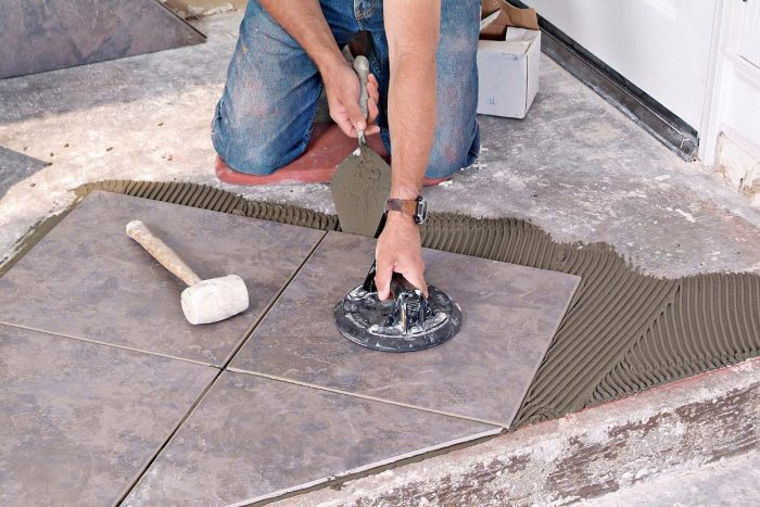 A margin trowel and suction lifter make it easy to lift tiles that need a bit more thinset under them.