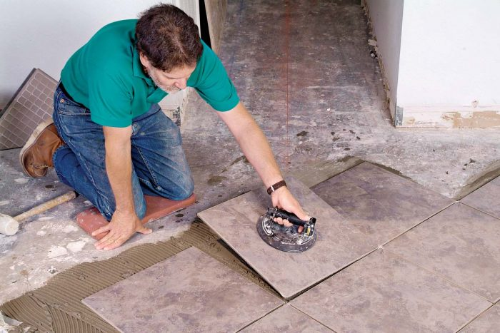 A suction lifter makes it easy to position large, heavy tiles or to lift tiles that need to be adjusted.